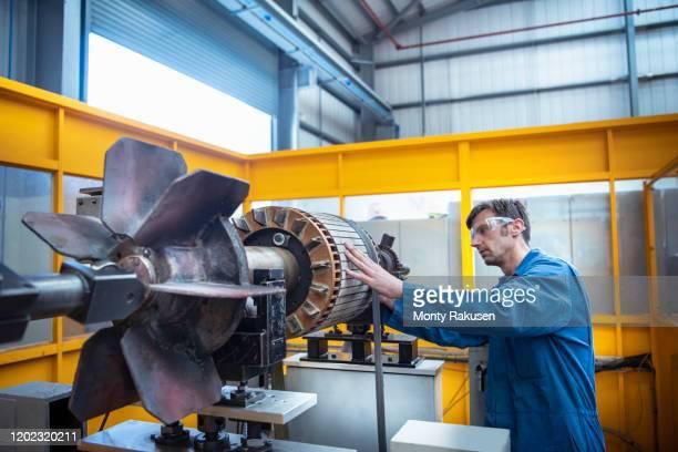 electrical engineer balancing generator part in electrical engineering factory - generator stock pictures, royalty-free photos & images