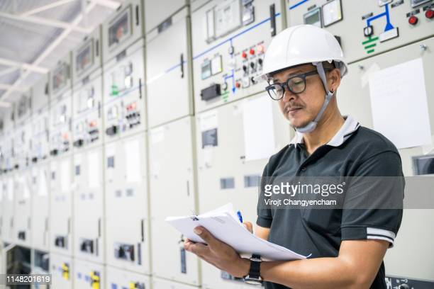 electrical engineer checking electrical control room, maintenance and service concept. - power supply stock pictures, royalty-free photos & images