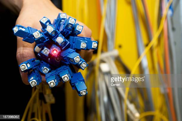 electrical engineer holding a bunch of fiber optics - data stream stock photos and pictures
