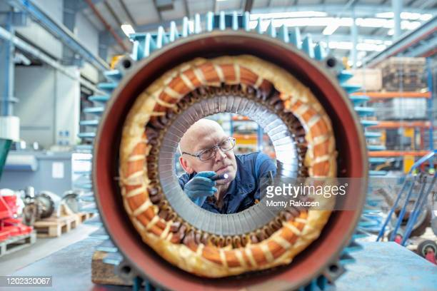 electrical engineer inspecting winding on generator stator in electrical engineering factory - circle stock pictures, royalty-free photos & images
