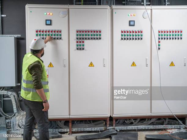 electrical engineer is working - electricity stock pictures, royalty-free photos & images