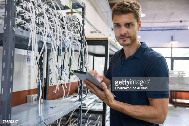 Electrical engineer using digital tablet in factory
