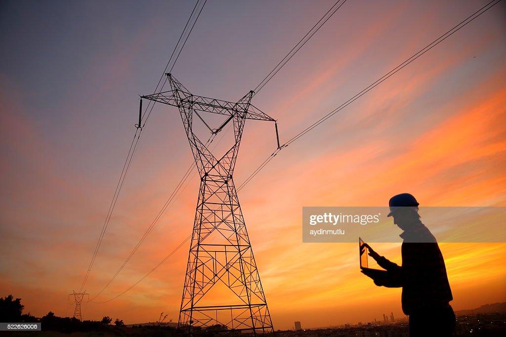 Electrical engineer while working laptopl : Stockfoto