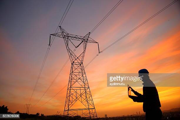 electrical engineer while working laptopl - telecommunications equipment stock pictures, royalty-free photos & images