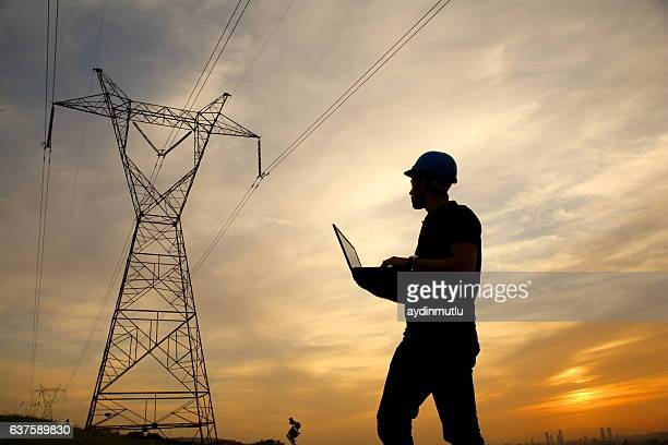 electrical engineer while working laptopl - power line stock pictures, royalty-free photos & images