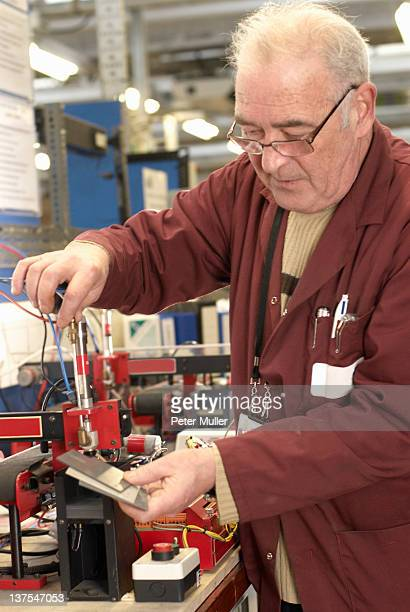 Electrical engineer working in shop