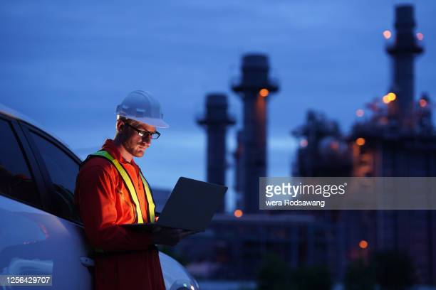 electrical engineer working over natural gas power plant - built structure stock pictures, royalty-free photos & images