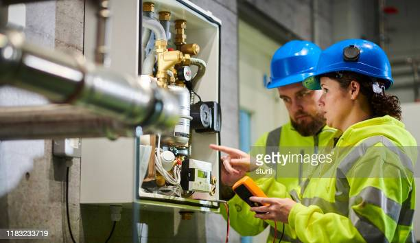 electrical engineers in boiler room - power supply stock pictures, royalty-free photos & images