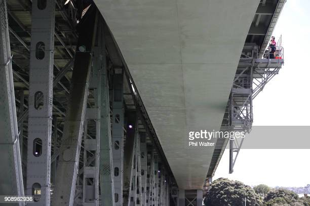 Electrical engineers make final checks and adjustments to strip lighting on the Auckland Harbour Bridge on January 23 2018 in Auckland New Zealand...