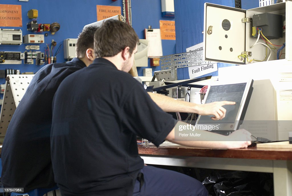 Electrical engineers working on computer : Stock Photo