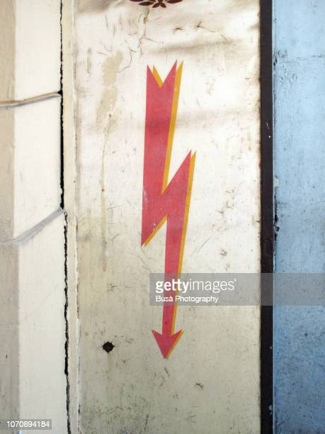 electrical hazard symbol on facade of building in berlin, germany - environmental signs and symbols stock pictures, royalty-free photos & images