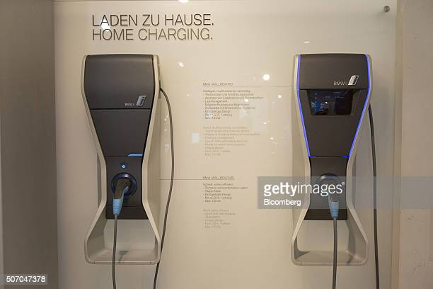 Electrical home charging wallboxes produced by Bayerische Motoren Werke AG sit on display inside the BMW World showroom in Munich Germany on Tuesday...