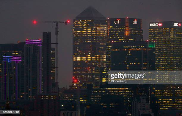 Electrical lights illuminate the floors of office skyscrapers including One Canada Square, center, Citigroup Inc., center right, and HSBC Holdings...
