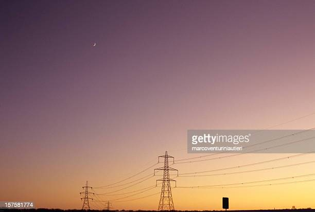Electrical Moon - Electricity pylons in a sunset sky