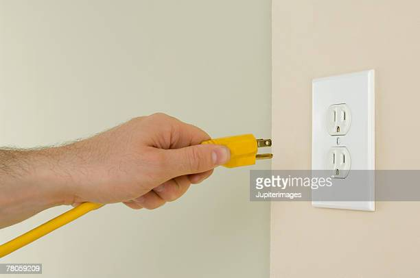 electrical outlet and plug - plugging in stock pictures, royalty-free photos & images