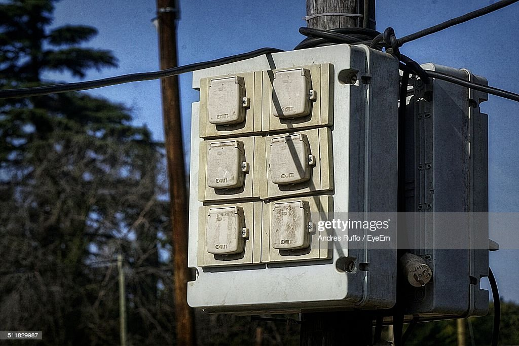 Electrical panel board at wooden pole : Stock Photo