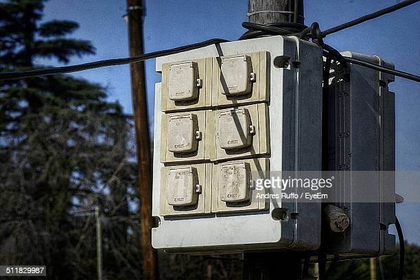 Electrical panel board at wooden pole