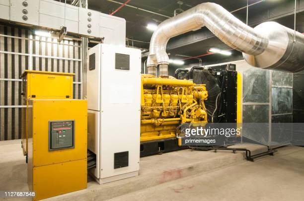 electrical power generator in large building interior - generator stock pictures, royalty-free photos & images