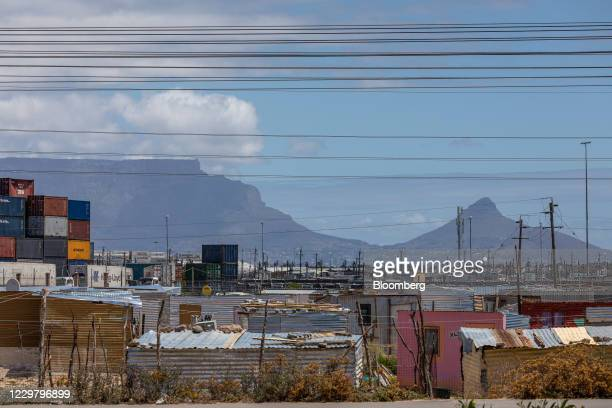 Electrical power lines above informal housing in front of Table Mountain in the Dunoon township in Cape Town, South Africa, on Wednesday, Nov. 25,...