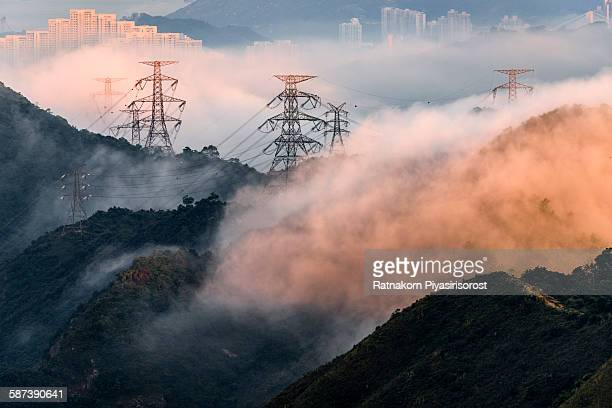 Electrical Power Lines and Pylons with Misty