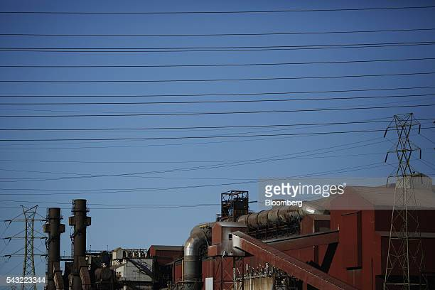 Electrical power lines cross the ArcelorMittal steel mill complex in Cleveland Ohio US on Friday June 24 2016 Benchmark US rates for steel surged 73...