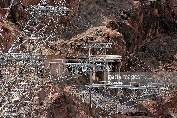 Electrical power lines run up from the Hoover Dam hydroelectric power plant near Boulder City Nevada US on Wednesday June 3 2009 There are 17...