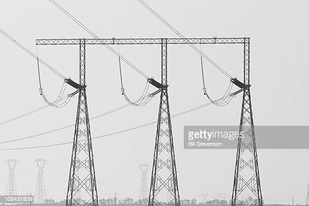 Electrical power transmission lines and towers