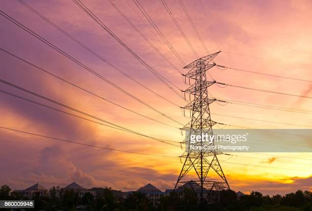 electrical pylons tower during sunset - electricity stock pictures, royalty-free photos & images