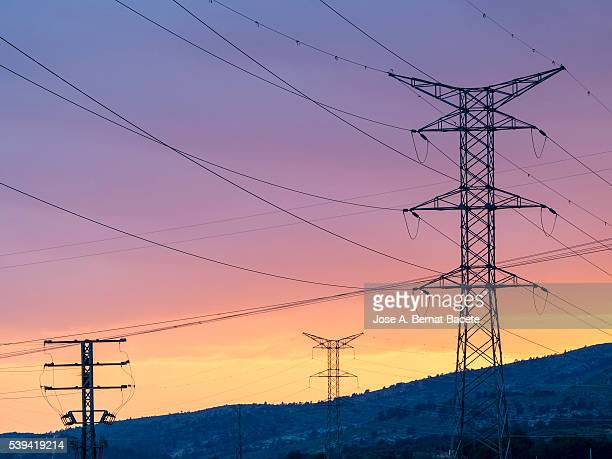 electrical towers and power lines in sunset - petechiae stock pictures, royalty-free photos & images