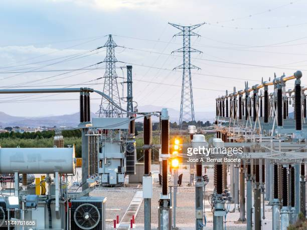 electrical transformer of high tension in a distribution electric power station of electricity power. - power line stock pictures, royalty-free photos & images