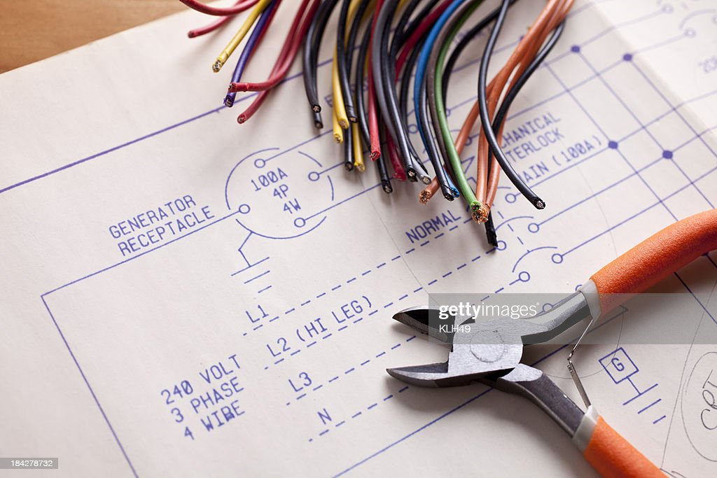 Electrical wiring with wire cutters and blueprints stock photo electrical wiring with wire cutters and blueprints stock photo malvernweather Image collections