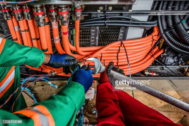 electrical work onboard production platform construction - port of spain stock pictures, royalty-free photos & images