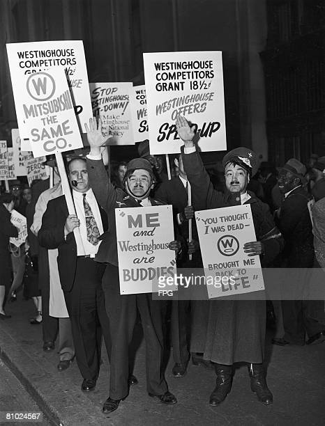 Electrical workers picket 40 Wall Street on the hundredth day of their strike April 1946 Tom Mancinaci and Charles Amrose lead the picketers dressed...