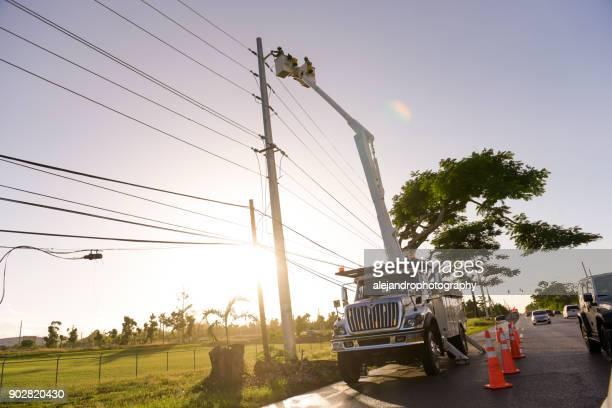 Electrical workers repairing power lines