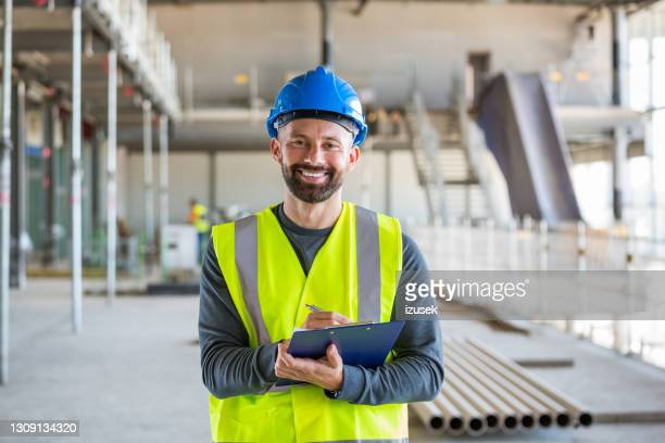 electrician at an indoor construction site - izusek stock pictures, royalty-free photos & images