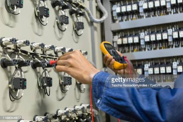 electrician checking fuse box - electrical panel box stock pictures, royalty-free photos & images