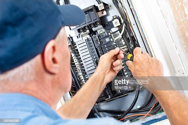 electrician doing electrical work in breaker box - electrician stock pictures, royalty-free photos & images
