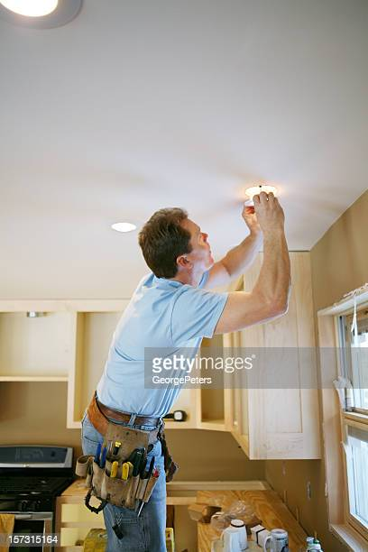 Electrician Installing Kitchen Light