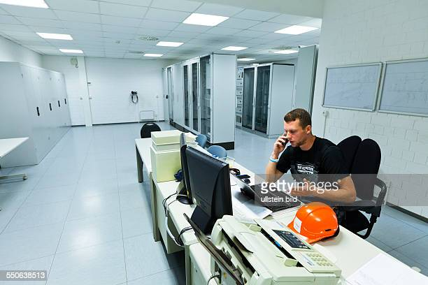 Electrician Marco Boernert at maintenance work in the operation building of an electrical substation of transmission system operator 50Hertz.