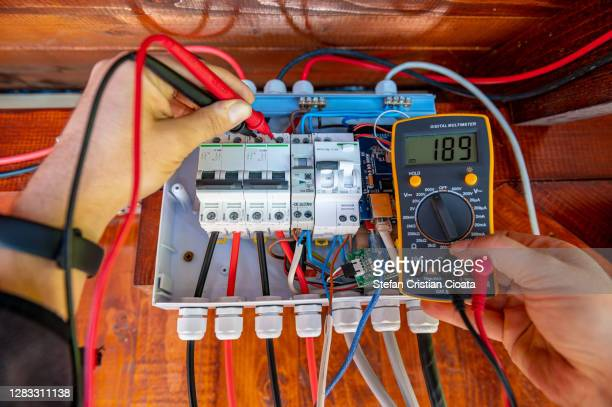 electrician measurements with multimeter tester system ready - electrical box stock pictures, royalty-free photos & images