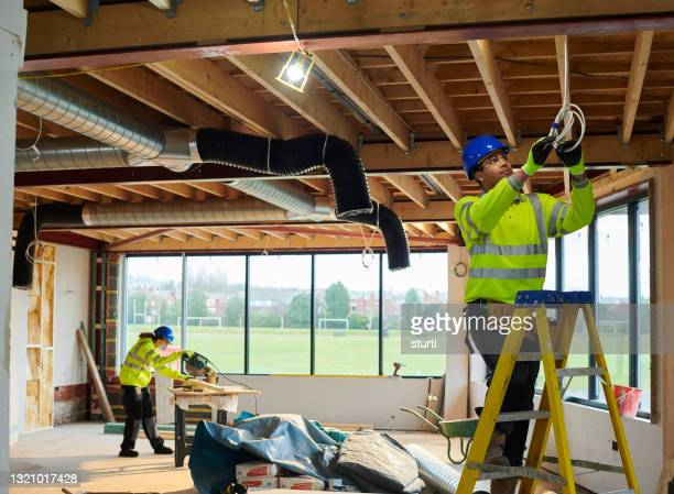 electrician on site - headwear stock pictures, royalty-free photos & images
