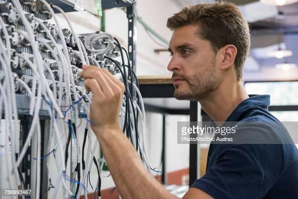 Electrician scrutinizing equipment