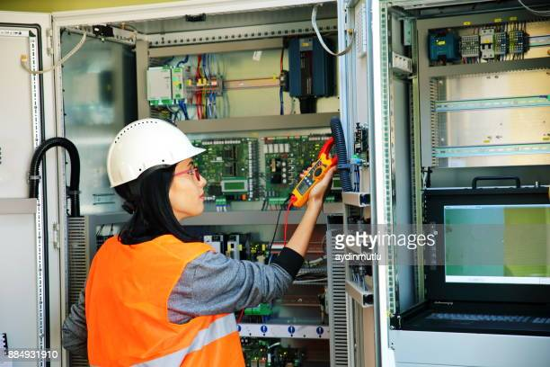 electrician testing for voltage in a fuse box - power supply stock pictures, royalty-free photos & images