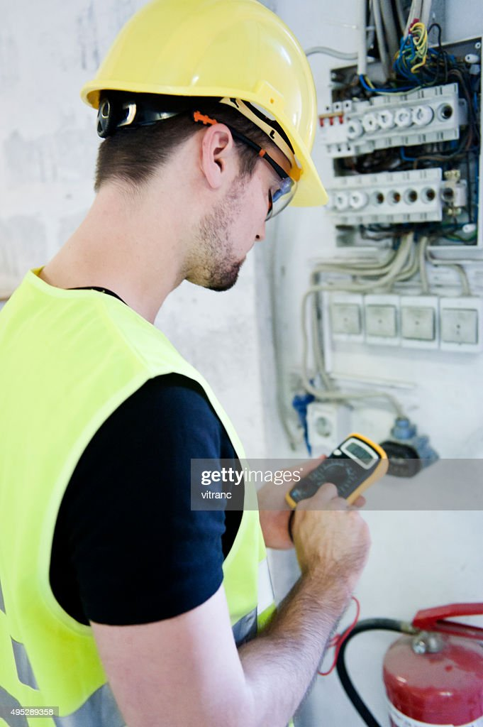 Electrician Testing Voltage : Stock Photo