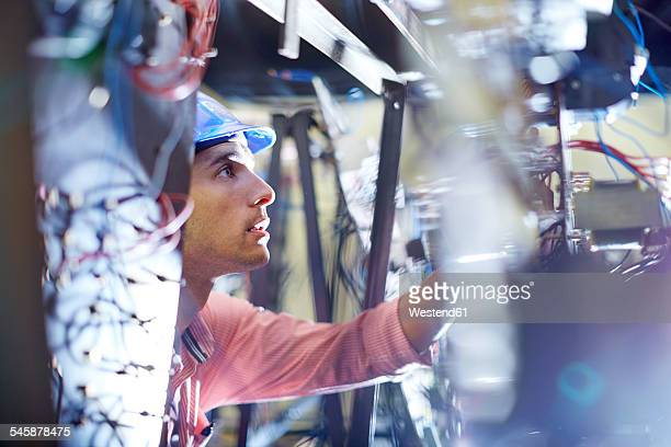 electrician testing wires - electricity stock pictures, royalty-free photos & images