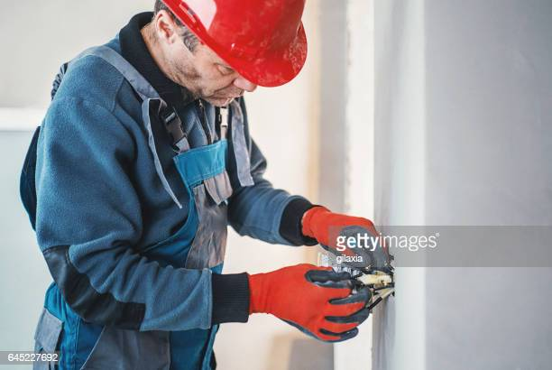 Electrician wiring a light switch.