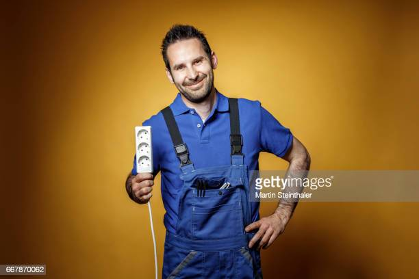 Electrician with power socket