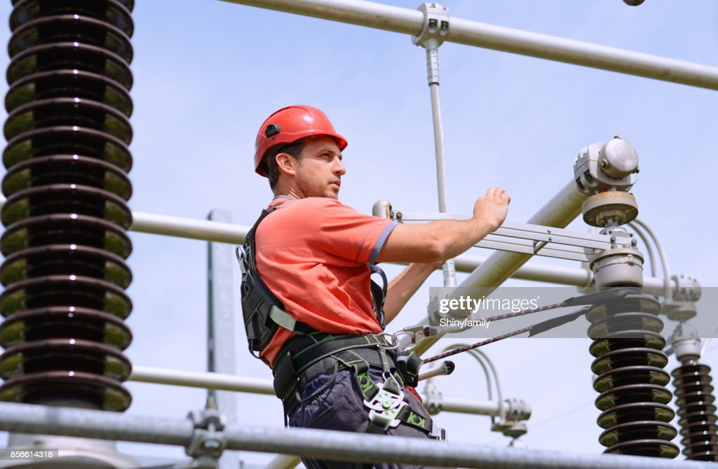 Electrician With Protective Workwear Hardhat And Safety