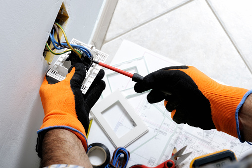 Electrician working in a residential electrical system 894471508