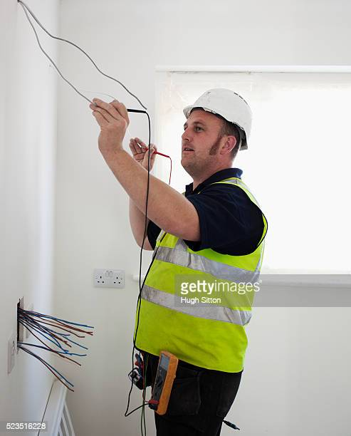 electrician working on construction site - hugh sitton stock pictures, royalty-free photos & images